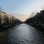A view of the Prinsengracht canal near the hotel at twilight.