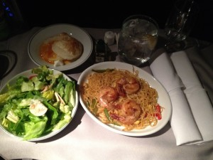 The mid-flight snack: noodles with shrimp, a salad, and glazed peaches with sugar puff pastry. It felt like we should have been eating breakfast, but it was 11pm!