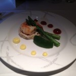 An appetizer with asparagus, shrimp and crab.