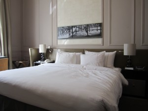 The room's king bed with leather headboard and built-in night reading lamps.