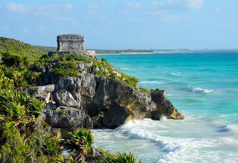 The ruins of the Mayan city of Tulum sit perched above the sea.