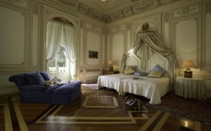 An opulent guest room at Pestana Palace.