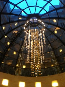 Elegant chandelier that welcomes guest into the hotel lobby.