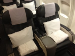 United's old business class recliner- thin, but comfortable with manual controls!