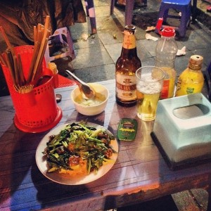 Street food like these noodles with beef and morning glory is one of Hanoi's great pleasures.