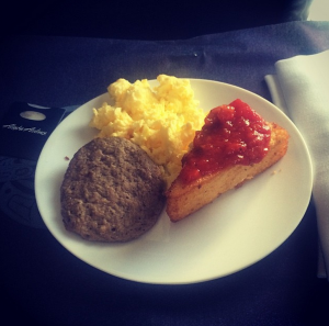 Not cheesecake: breakfast  polenta and marinara with eggs and a sausage patty