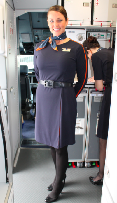 JetBlue flight lead Deborah showcasing the new uniforms by Stan Herman