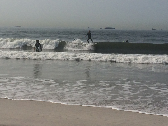 Surfers tearing it up the day I visited Long Beach.