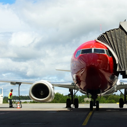 Airplane refueling at gate featured image