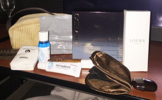 JAL's first-class amenity kit, packaged in a corduroy toiletry kit. includes products from Spanish company Loewe.