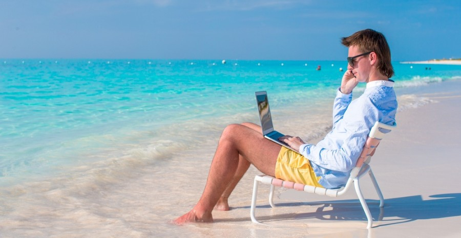 You may not want to stay connected when visiting a secluded beach, but many carriers allow it! Image courtesy of Shutterstock.