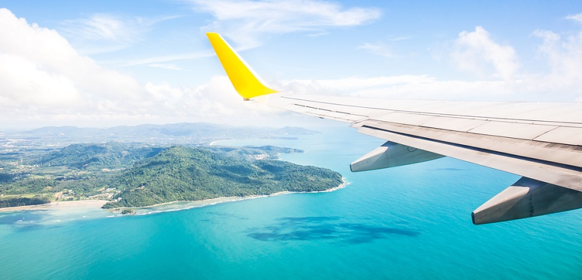 Airplane wing ocean island featured 2 shutterstock 262466249