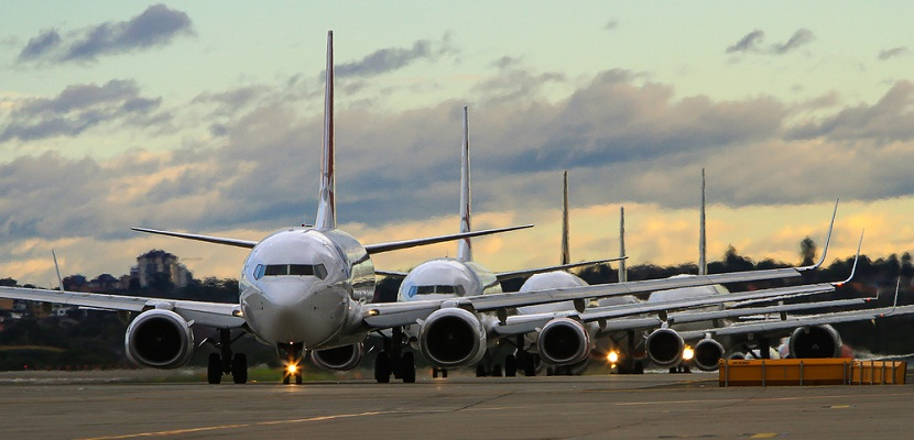 airplanes in line on runway full shutterstock 198700100