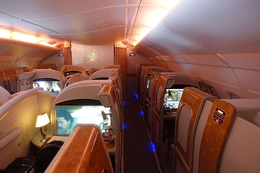 The first-class cabin bathed in serene mood lighting.