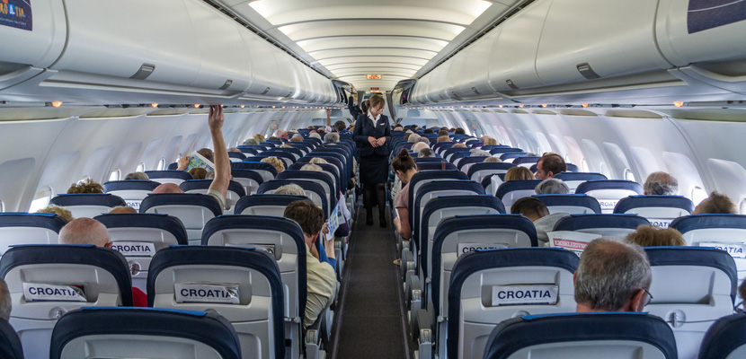 Airplane Cabin Passengers Featured