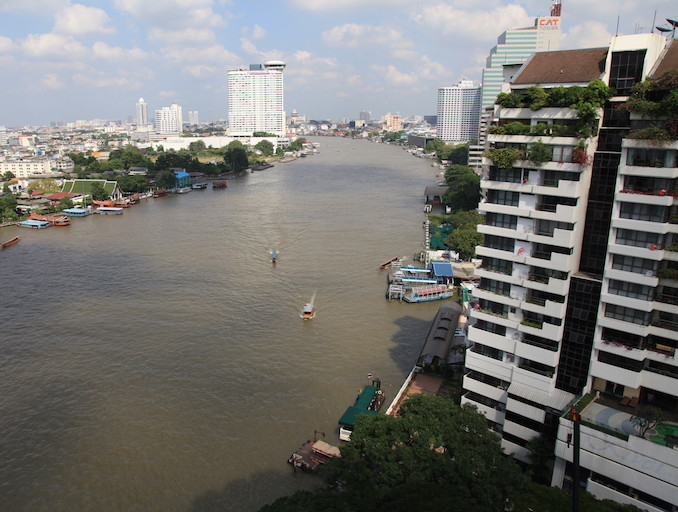 The view from luxury high-rise hotels in Bang Rak, along the Chao Phraya River, make Bangkok look calm and peaceful