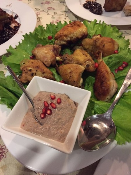 Lightly fried chicken with a walnut and pomegranate sauce.