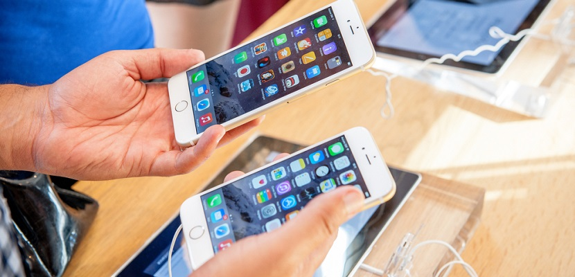 iPhone shopping electronics featured shutterstock 218533315