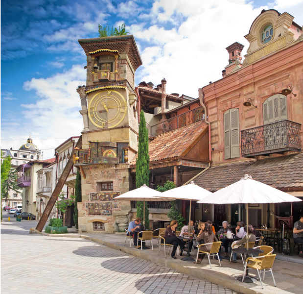 """Café Gabriadze sits at the foot of Tbilisi's own """"leaning tower"""" and is a great stepping off point into the old city. Photo courtesy of Shutterstock."""