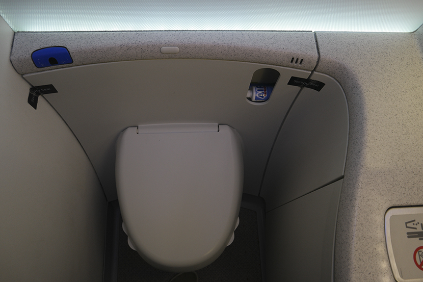 Tabbed toilet seat so you don't have to touch the rim: Brilliant! Image courtesy of Kofi Lee-Berman.