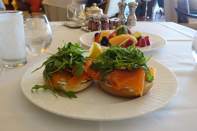 Bagels with smoked salmon, arugula and avocado.
