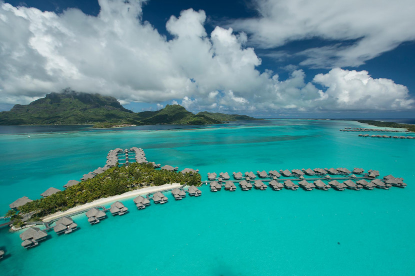 Stay in one of the overwater bungalows at The St. Regis Bora Bora Resort overlooking the lagoon.