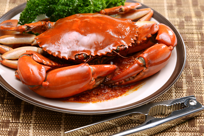 Singaporean chili crab is gently simmered in a spicy, sweet-savory sauce for optimal flavor. Photo courtesy of Shutterstock.