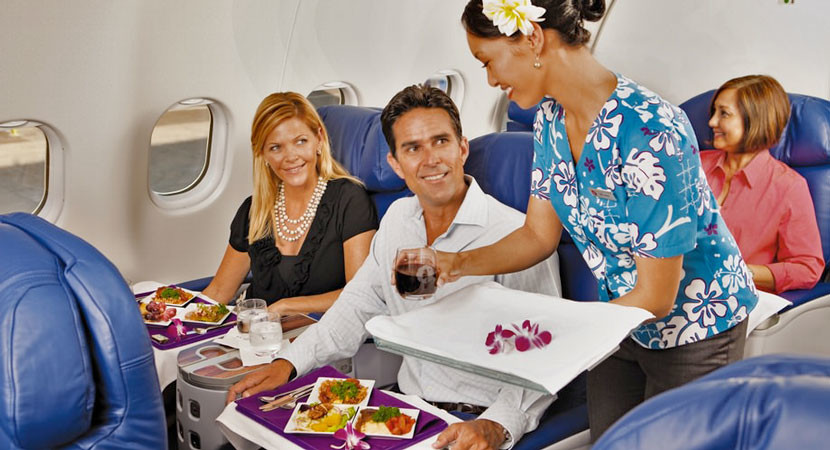 …but the old seats are as dated as this guy's hair. Image courtesy of Hawaiian Airlines.