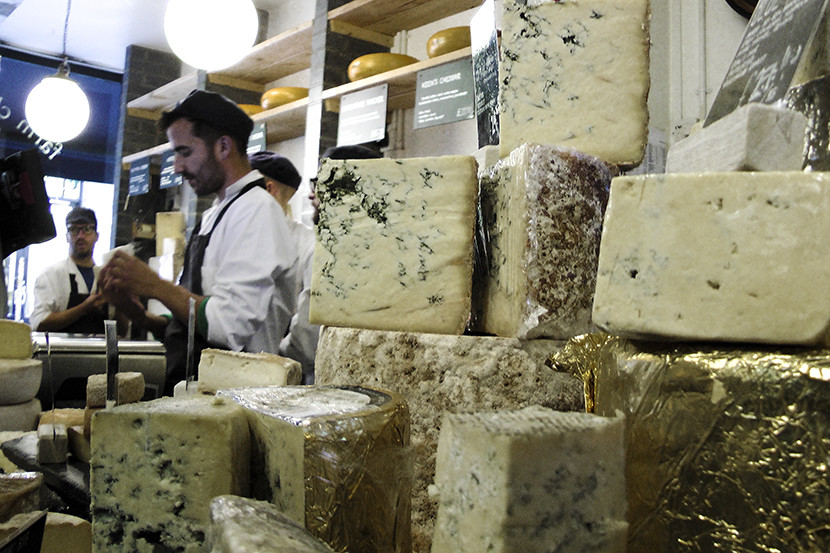 In Neal's Yard Dairy, cheese is elevated to a religion and cheesemongers dish up samples with evangelical fervor. Image courtesy of Mitch Berman.