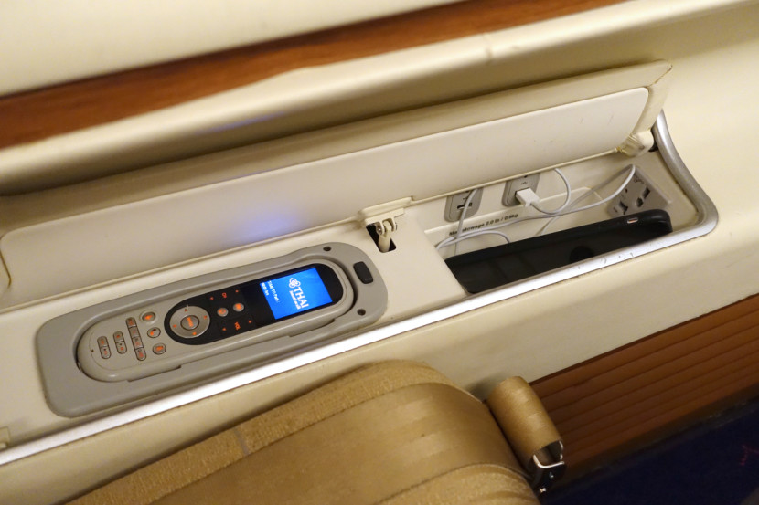 Each seat includes a handheld controller, a universal power outlet and two USB ports for charging gadgets.