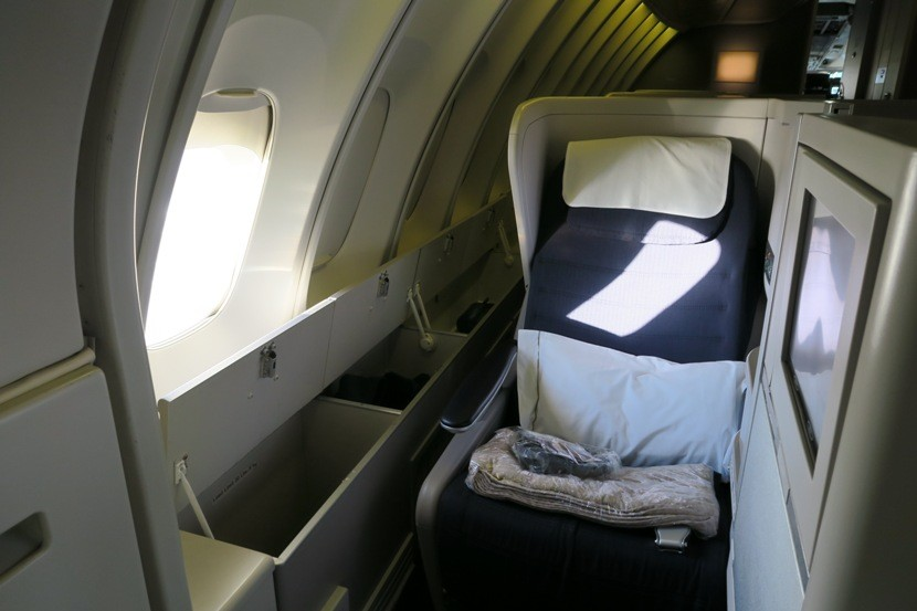 Seat 62A was stocked with a pillow, blanket and headphones.