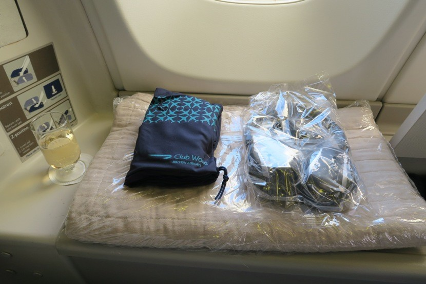 Once closed, the window-side locker served as a table for my welcome drink as wella resting place for my amenity kit, headphones and blanket.