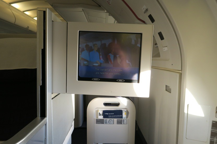 The aged in-flight entertainment system was barely visible for the safety video shown during taxi.