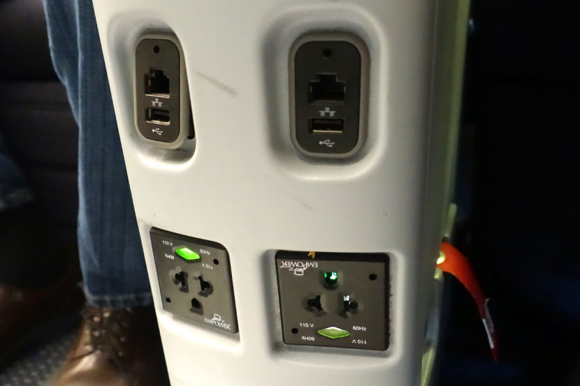 Each seat includes an outlet and USB port.
