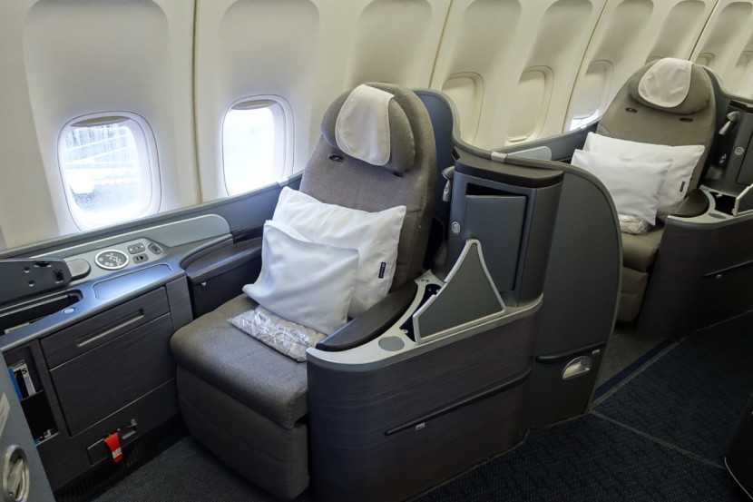 First-class passengers get two pillows and a blanket.