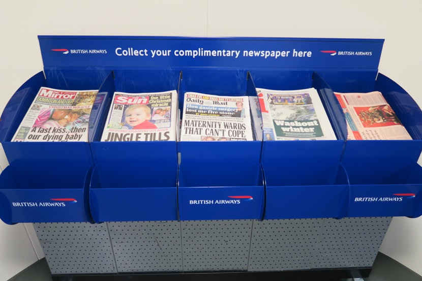Need something to read on this flight? Complimentary newspapers were available to all on the jetway.