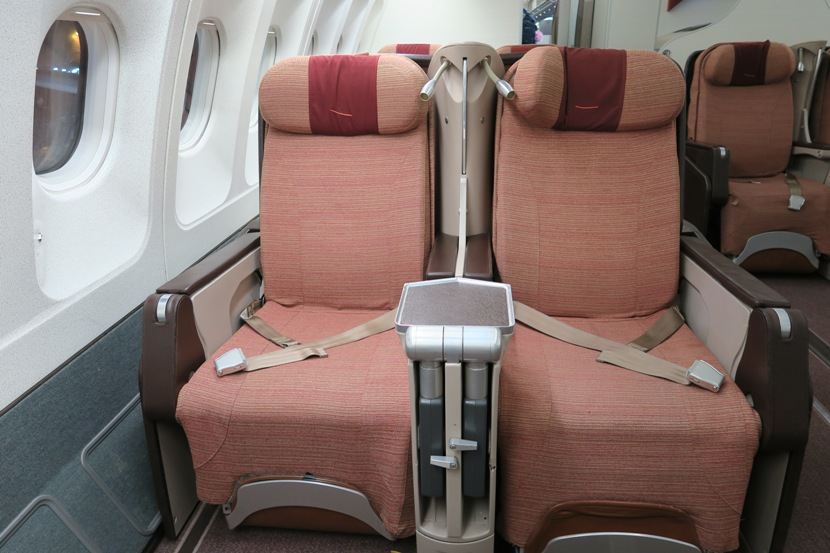 The in-flight entertainment screens are stored between the seats.