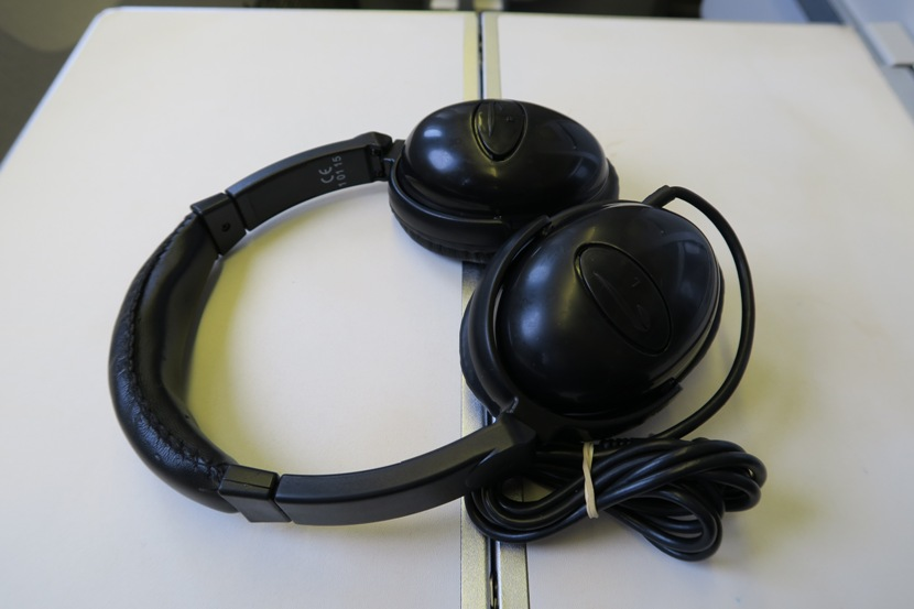 The provided headphones were good enough to block out the cabin noise and provide clear sound.