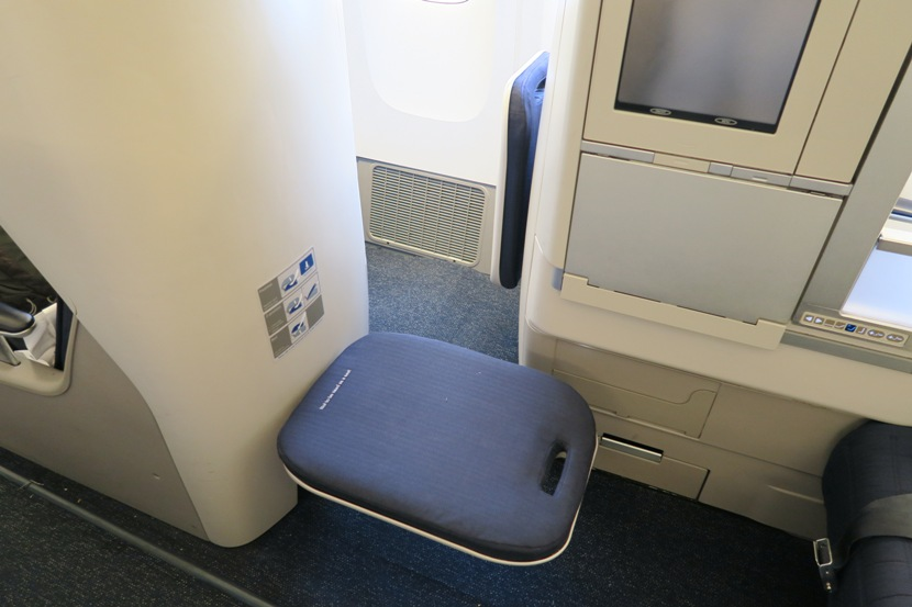 The narrow opening to reach the window seats is made harder if your cabinmate has their footrest down.