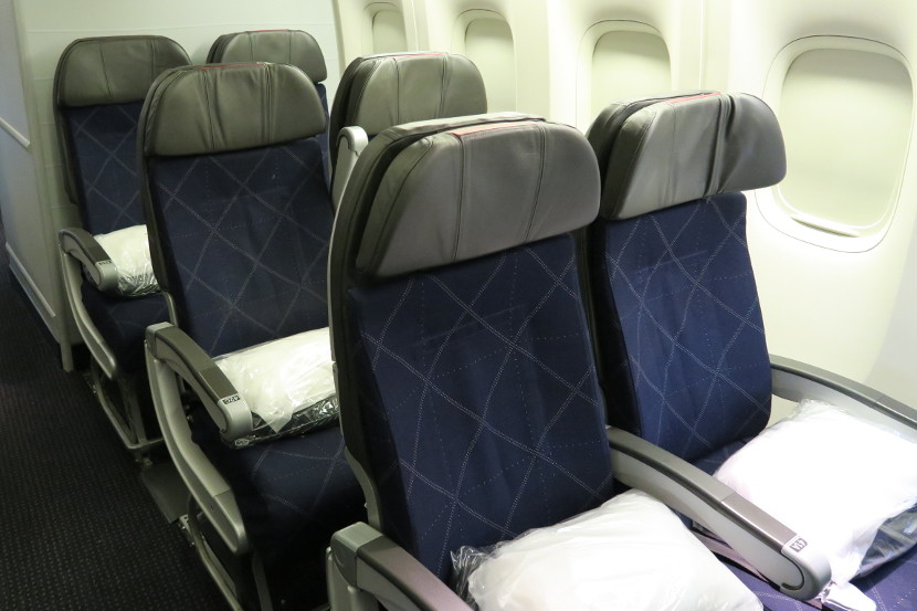 In the 3-4-3 economy cabin, the few pairs of seats in the back of the cabin can be perfect for couples.