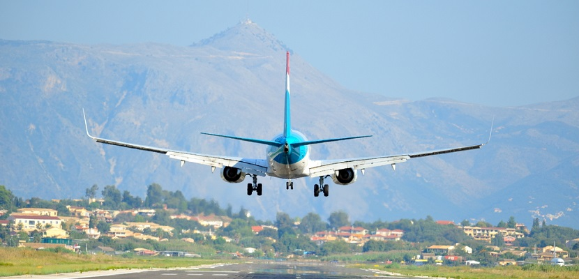 Plane landing Corfu mountains featured shutterstock 56429125