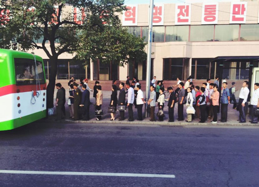 People waiting for the bus in North Korea