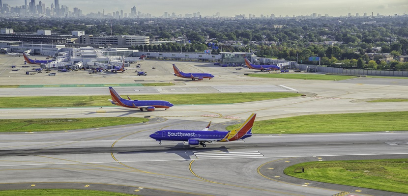Southwest planes on runway Chicago featured shutterstock 347960354